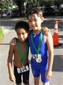 Two young boys wearing medals at the Gardens Splash and Dash