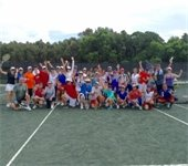 A large group of adults on the tennis court at Hitting Frenzy