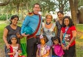 Staff dressed up as fairy tale characters with three ladies and three young girls in costume