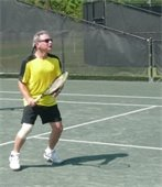 A man playing tennis on the tennis court