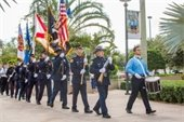 Police and Fire Department Honor Guard processing with the flags