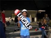A teenage boy holding a skateboard