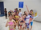 Boys and girls standing on the pool deck at Aquatic Camp