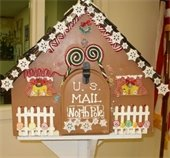 Santa's mailbox decorated as a gingerbread house