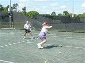 A man and woman playing tennis