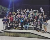 A large group of skate boarders