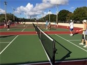 Men and women playing Pickleball on outdoor Pickleball courts