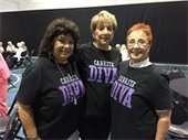 "Three women wearing ""Canasta Diva"" t-shirts"
