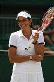Gigi Fernandez holding a tennis racket.