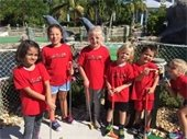 Young boys and girls at a miniature golf course