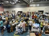 People shopping at the Indoor Yard Sale
