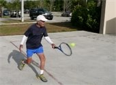 A man practicing tennis
