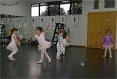 Five little girls dancing in dance attire