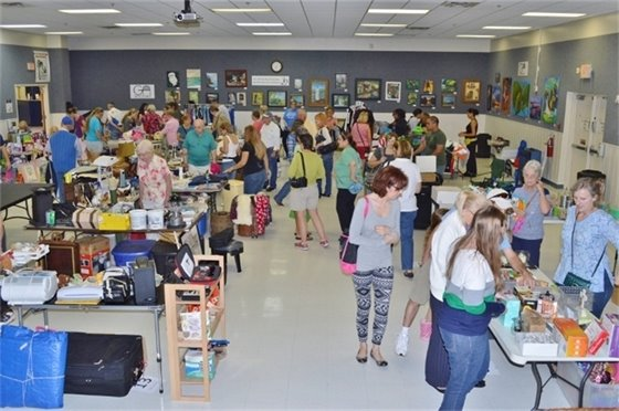 Sellers and shoppers at the Indoor Yard Sale